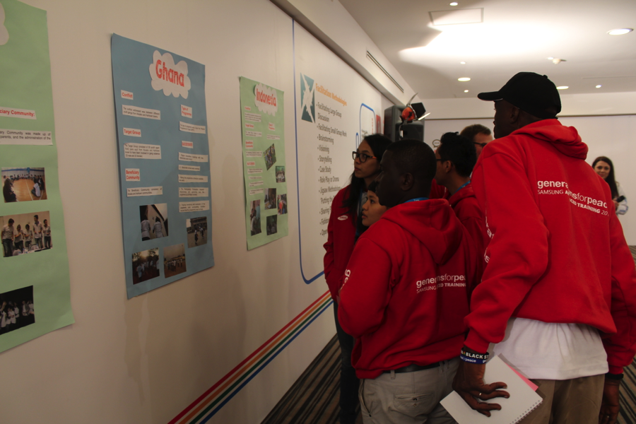The Pioneers studying the programme presentations during the